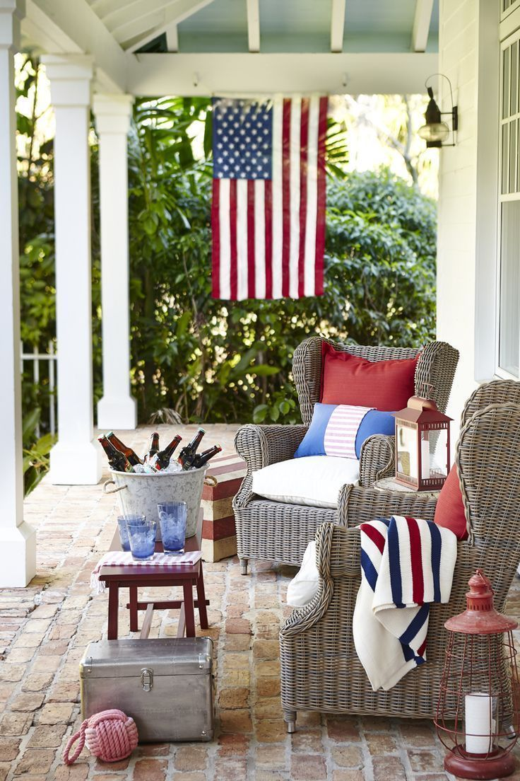 coastal-patio-with-red-white-and-blue-decor-and-an-american-flag-hanging