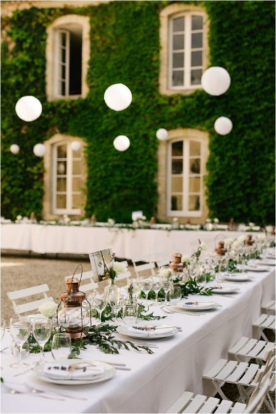 Tables and Lanterns at French Wedding Reception | Photo by CHRIS+LYNN Photographers