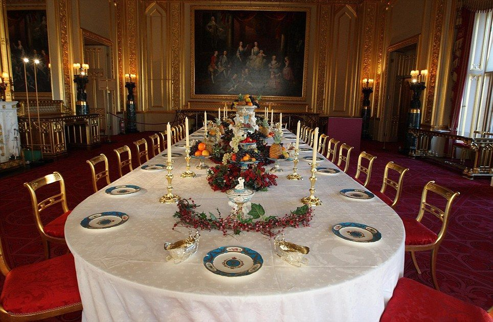 The finishing touches are made to the table in Windsor Castle's state dining room, which has be laid for a Victorian Christmas feast with a lavish porcelain dessert service by Minton of Staffordshire, which Queen Victoria bought at the Great Exhibition of 1851. PRESS ASSOCIATION Photo. Picture date: Friday November 25, 2011. See PA story ROYAL Christmas. Photo credit should read: Steve Parsons/PA Wire